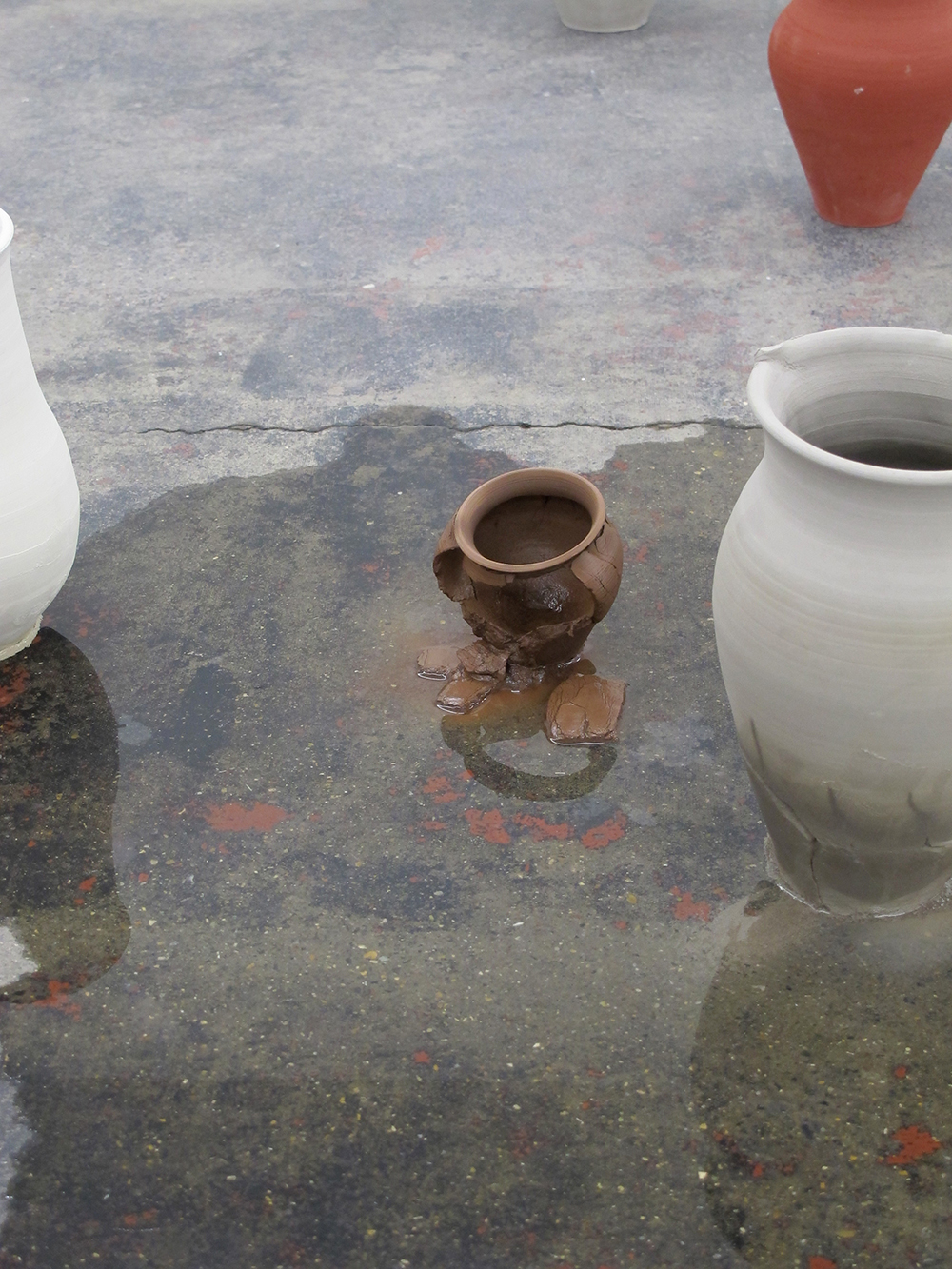 unfired clay, water